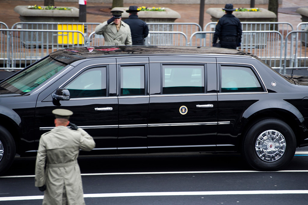 . Members of the Army salute as the Presidential motorcade drives on Pennsylvania Avenue to the Capitol for the Inauguration of President-elect Donald Trump in Washington, Friday, Jan. 20, 2017. (AP Photo/Cliff Owen)