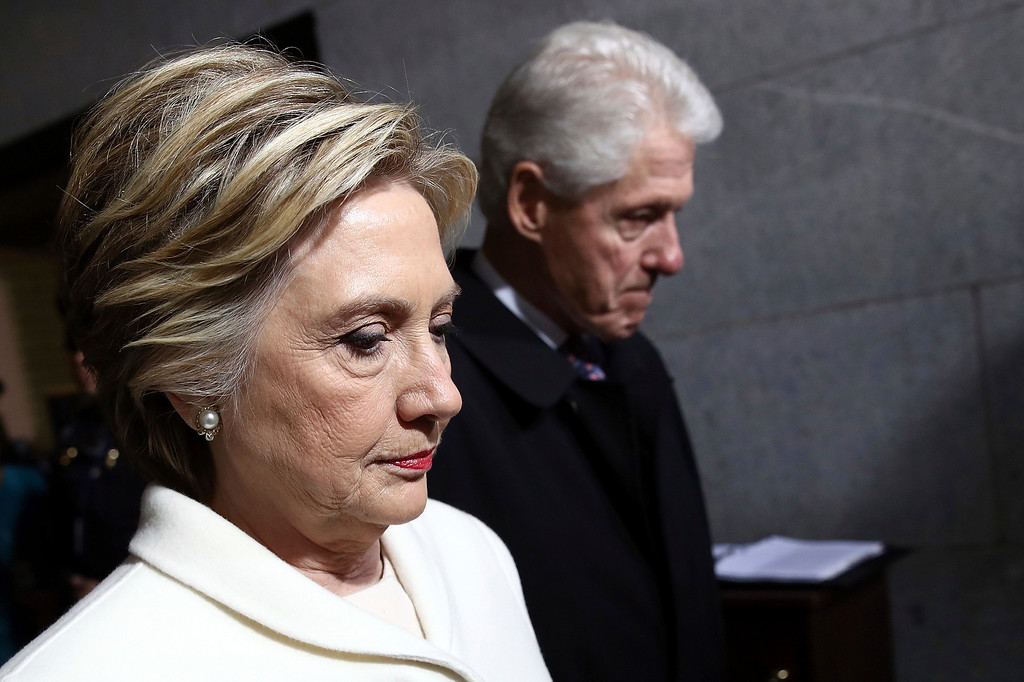 . Former Sen. Hillary Clinton and former President Bill Clinton arrive on the West Front of the U.S. Capitol on Friday, Jan. 20, 2017, in Washington, for the inauguration ceremony of Donald J. Trump as the 45th president of the United States. (Win McNamee/Pool Photo via AP)