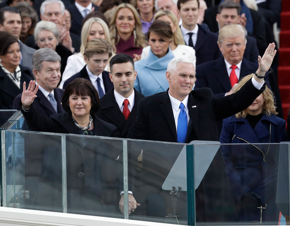 . Vice President Mike Pence, flanked by his wife Karen, waves after being sworn in during the 58th Presidential Inauguration at the U.S. Capitol in Washington, Friday, Jan. 20, 2017.(AP Photo/Patrick Semansky)