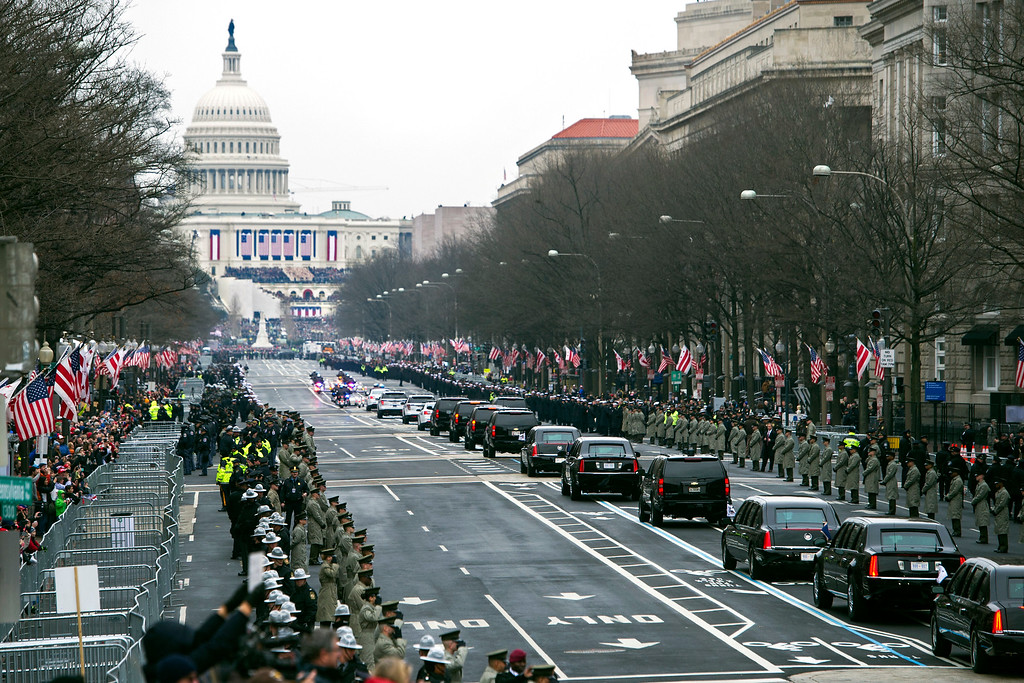 . The Presidential motorcade drives on Pennsylvania Avenue to the Capitol for the Inauguration of President-elect Donald Trump, Friday, Jan. 20, 2017, in Washington. (AP Photo/Cliff Owen)