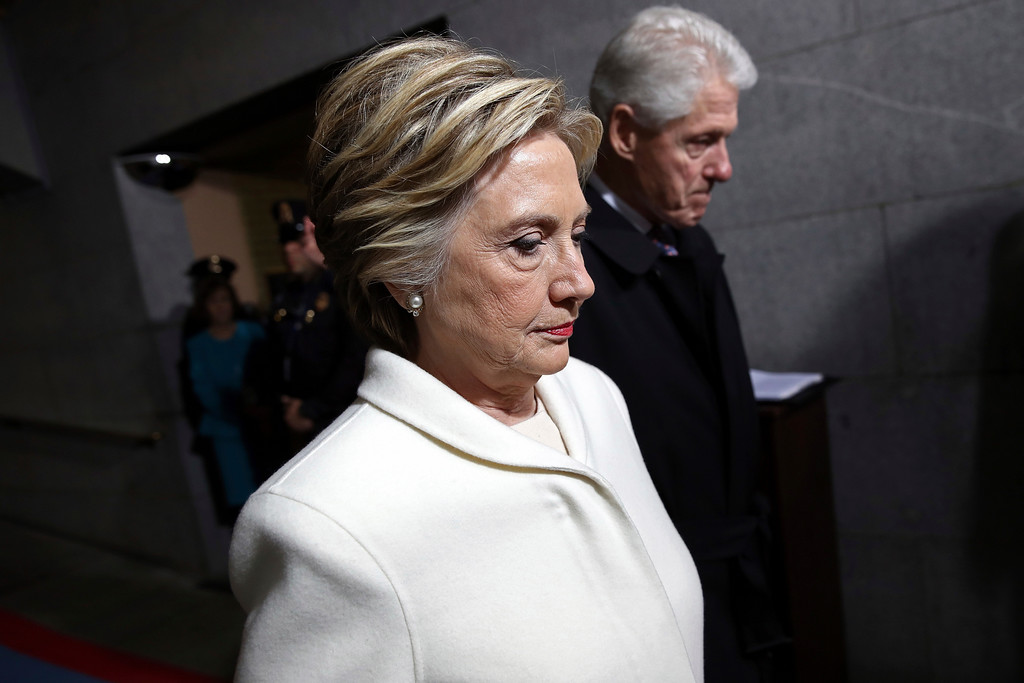 . Former Presidential Bill Clinton and wife Hillary Clinton arrive on the West Front of the Capitol in Washington, Friday, Jan. 20, 2017, for the presidential inauguration of Donald Trump. (Win McNamee via AP, Pool)