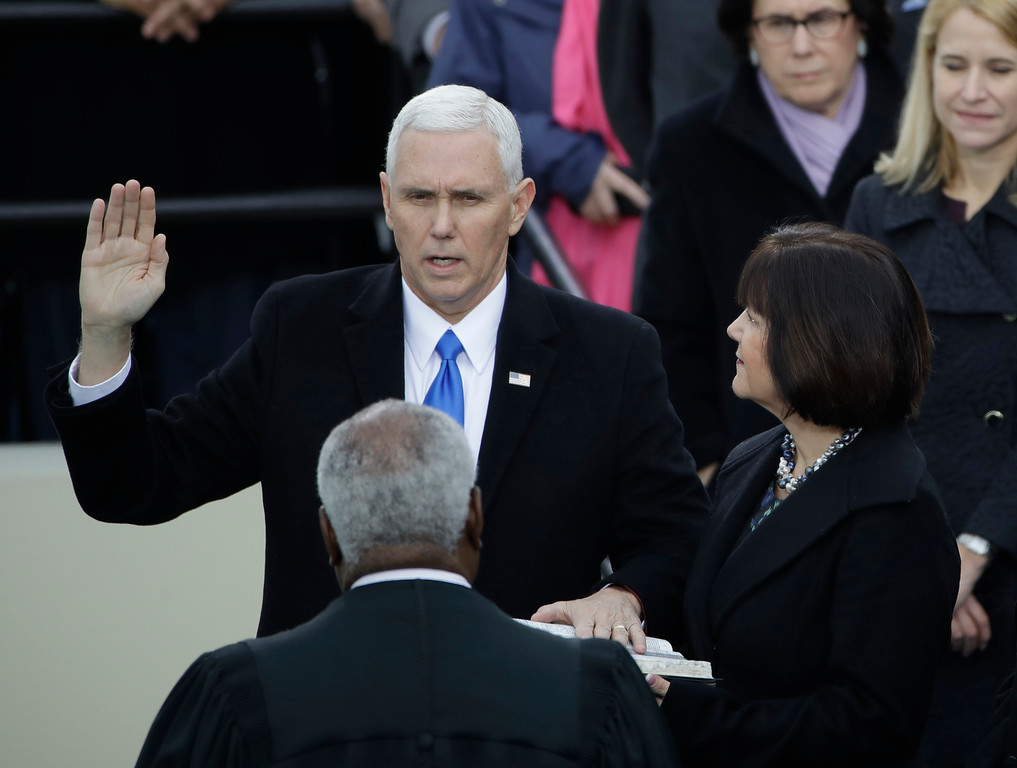 . Vice President Mike Pence takes his oatch of office during the 58th Presidential Inauguration at the U.S. Capitol in Washington, Friday, Jan. 20, 2017. At his right is his wife Karen. (AP Photo/Matt Rourke)