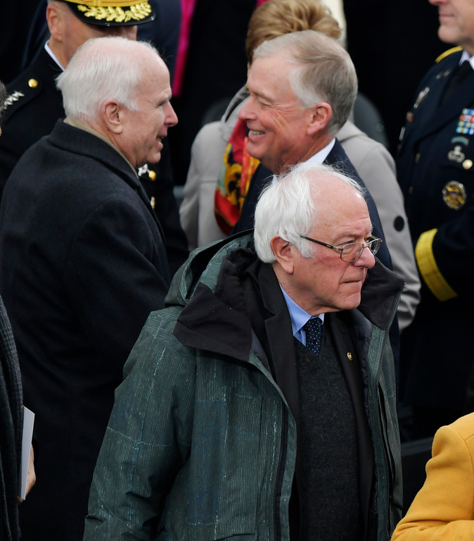 . Senator Bernie Sanders I-Vt., front right, arrives as Senator John McCain R-Ariz. speaks to former Vice-President Dan Quayle for the 58th Presidential Inauguration for President-elect Donald Trump at the U.S. Capitol in Washington, Friday, Jan. 20, 2017.(AP Photo/Susan Walsh)