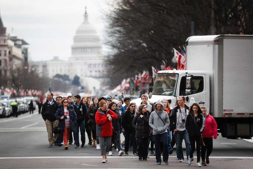 . With the Capitol in the background, crowds walk along Pennsylvania Avenue in Washington, Thursday, Jan. 19, 2017, as preparations continue for Friday\'s presidential inauguration. (AP Photo/John Minchillo)