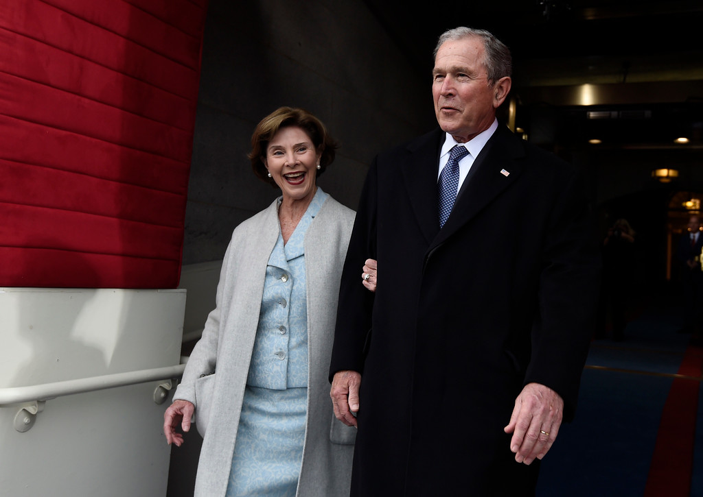 . Former US President George W. Bush and First Lady Laura Bush arrive for the Presidential Inauguration of Donald Trump at the US Capitol in Washington, DC, January 20, 2017. / AFP PHOTO / POOL / SAUL LOEB