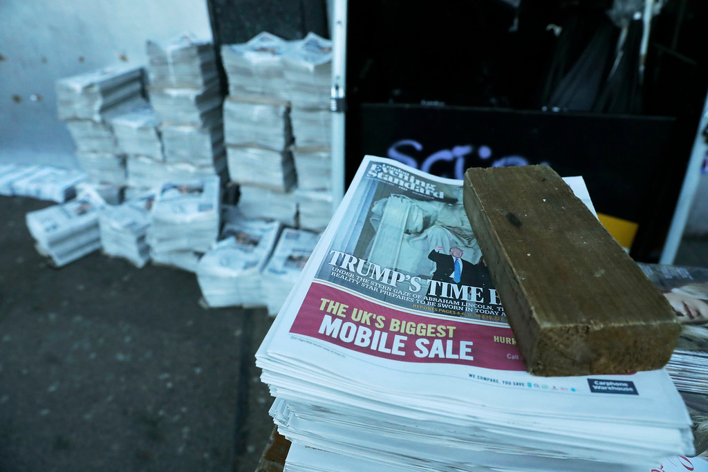 . The front page of the London Evening Standard newspaper reports on Donald Trump\'s inauguration as U.S. President, as copies are laid out for distribution outside Waterloo train station in London, Friday, Jan. 20, 2017. (AP Photo/Matt Dunham)