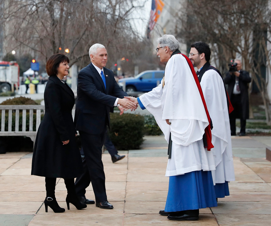 . Vice President-elect Mike Pence and his wife Karen are greeted by. Rev. Luis Leon as they arrive for a church service at St. John�s Episcopal Church across from the White House in Washington, Friday, Jan. 20, 2017, on Donald Trump\'s inauguration day. (AP Photo/Alex Brandon)
