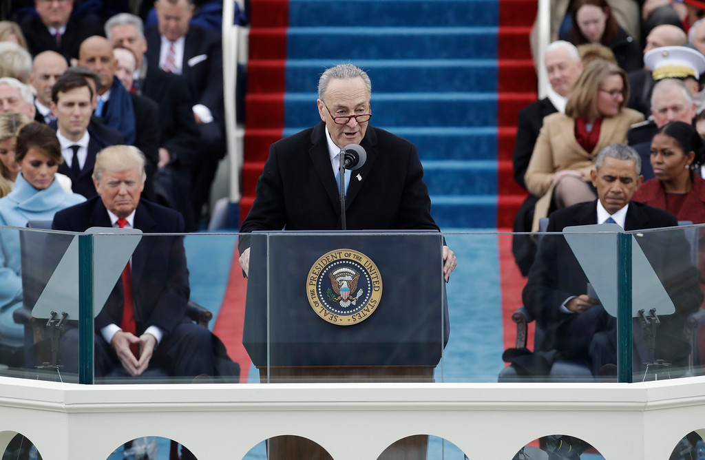 . Senator Chuck Schumer, D-NY speaks during the 58th Presidential Inauguration at the U.S. Capitol in Washington, Friday, Jan. 20, 2017. President-elect Donald Trump, right listens with President Barack Obama, right. (AP Photo/Patrick Semansky)