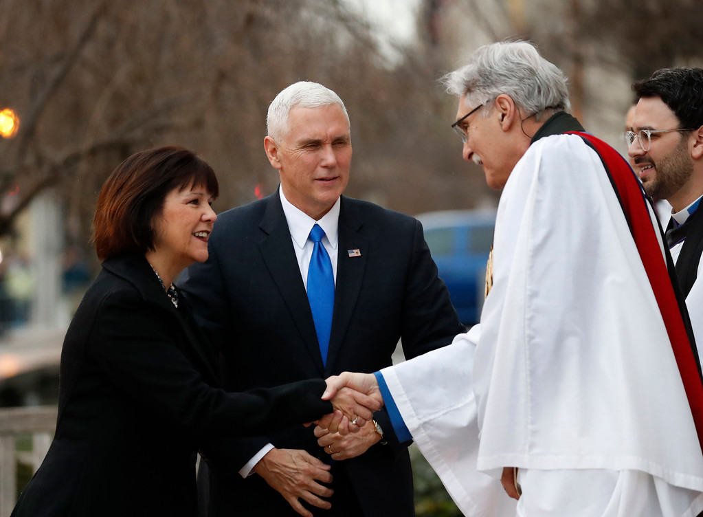 . Rev Luis Leon greets Vice President-elect Mike Pence and his wife Karen upon their arrival for church service at St. John�s Episcopal Church across from the White House in Washington, Friday, Jan. 20, 2017, on Donald Trump\'s inauguration day. (AP Photo/Alex Brandon)