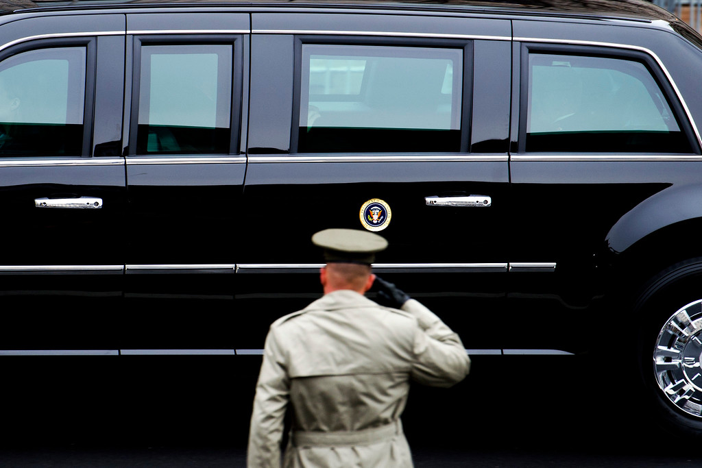 . A member of the Army salutes as the Presidential motorcade drives on Pennsylvania Avenue to the Capitol for the Inauguration of President-elect Donald Trump in Washington, Friday, Jan. 20, 2017. (AP Photo/Cliff Owen)