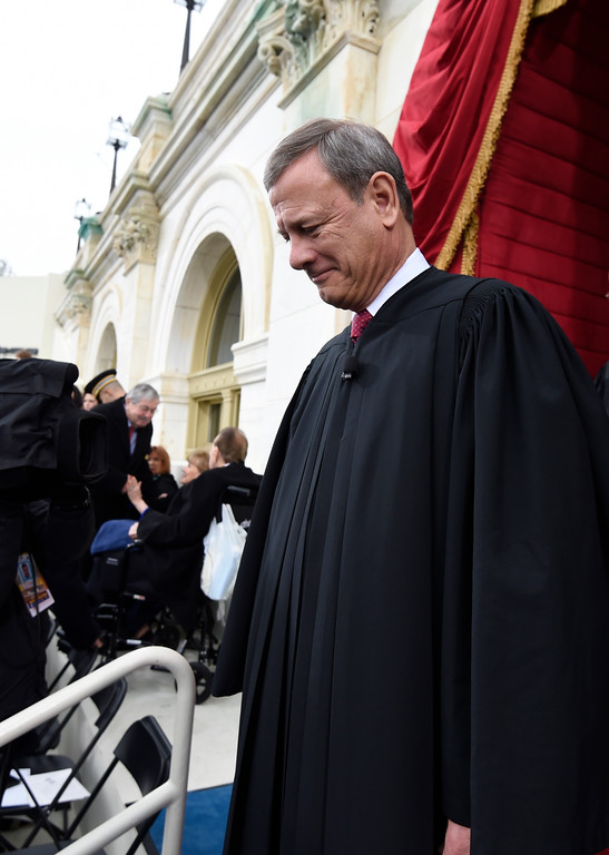 . Chief Justice John Roberts arrives on Capitol Hill in Washington, Friday, Jan. 20, 2017, for the presidential inauguration of Donald Trump. (Saul Loeb via AP, Pool)