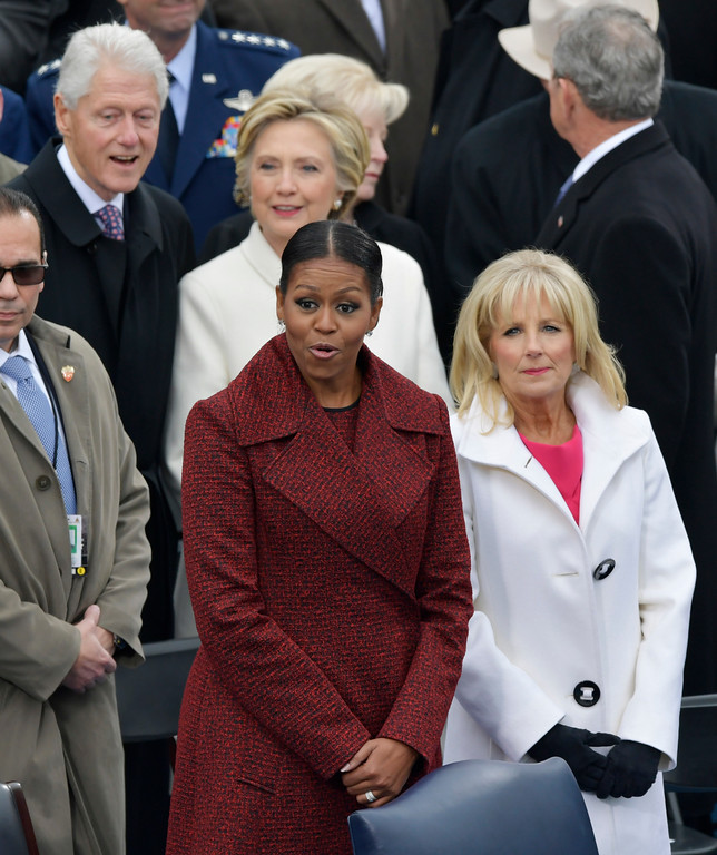 . First Lady Michelle Obama, left, stands with Vice President Joe Biden\'s wife, Dr. Jill Biden for the 58th Presidential Inauguration for President-elect Donald Trump at the U.S. Capitol in Washington, Friday, Jan. 20, 2017. (AP Photo/Susan Walsh)