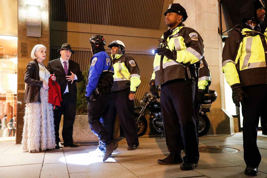 . Police prevent party-goers from entering the National Press Building due to a street protest ahead of the presidential inauguration, Thursday, Jan. 19, 2017, in Washington. (AP Photo/John Minchillo)