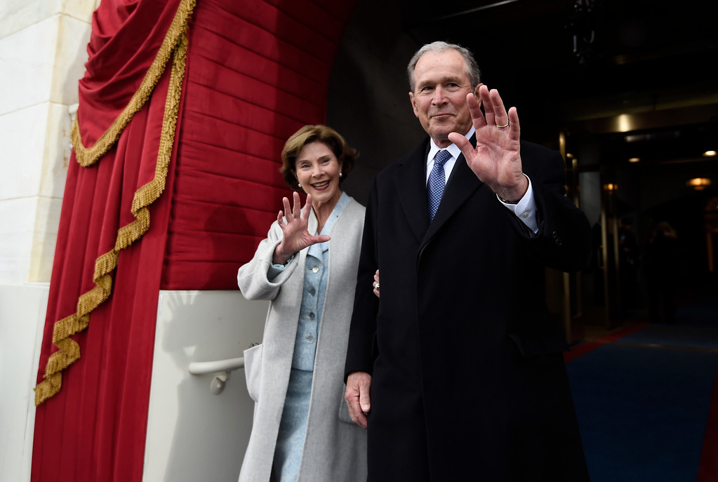 . Former President George W. Bush and his wife Laura Bush wave as they arrive on Capitol Hill in Washington, Friday, Jan. 20, 2017, for the presidential inauguration of Donald Trump. (Saul Loeb via AP, Pool)