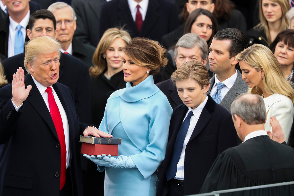 . Donald Trump is sworn in as the 45th president of the United States by Chief Justice John Roberts as Melania Trump looks on during the 58th Presidential Inauguration at the U.S. Capitol in Washington, Friday, Jan. 20, 2017. (AP Photo/Andrew Harnik)