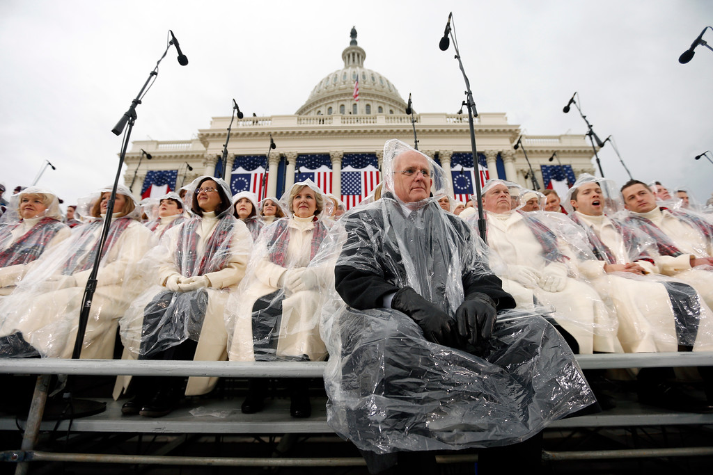 . Members of the Mormon Tabernacle Choir sit in the rain waiting for the swearing in of Donald Trump as the 45th president of the United States to begin during the 58th Presidential Inauguration at the U.S. Capitol in Washington. Friday, Jan. 20, 2017 (AP Photo/Carolyn Kaster)