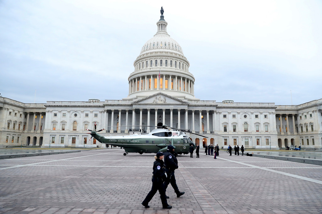 . A military helicopter lands on Capitol Hill in Washington, Friday, Jan. 20, 2017, for the inauguration of Donald Trump becoming the 45th president of the United States. (Rob Carr via AP, Pool