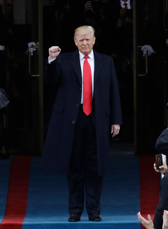 . President-elect Donald Trump pumps his fist as he arrives for his Presidential Inauguration at the U.S. Capitol in Washington, Friday, Jan. 20, 2017. (AP Photo/Patrick Semansky)