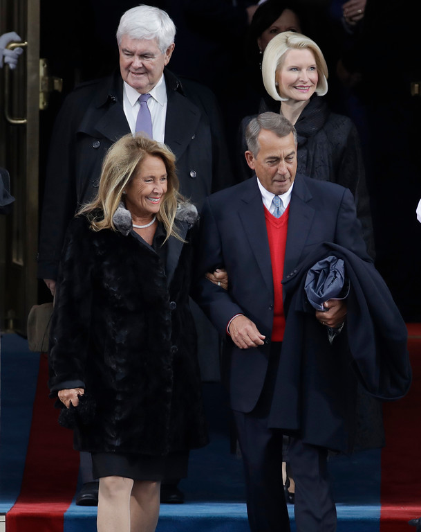 . Former Speaker John Boehner, front right, of Ohio arrives with his wife Debbie followed by former House Speaker Newt Gingrich and his wife Callista before the 58th Presidential Inauguration at the U.S. Capitol in Washington, Friday, Jan. 20, 2017. (AP Photo/Patrick Semansky)
