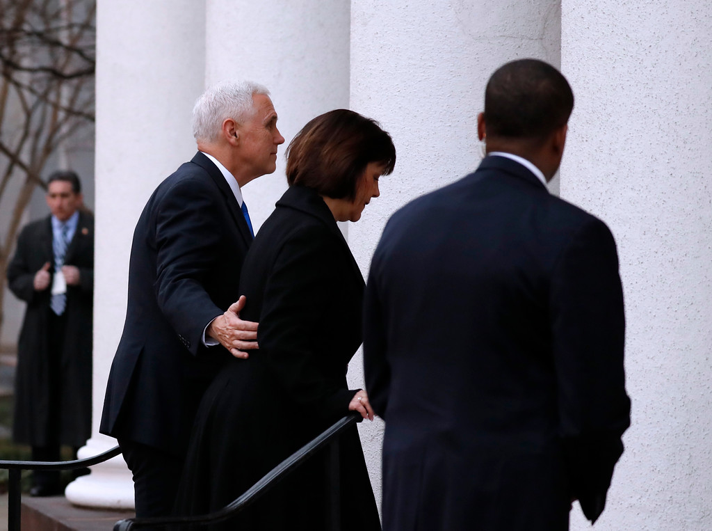 . Vice President-elect Mike Pence and his wife Karen arrives for a church service at St. John�s Episcopal Church across from the White House in Washington, Friday, Jan. 20, 2017, on Donald Trump\'s inauguration day. (AP Photo/Alex Brandon)