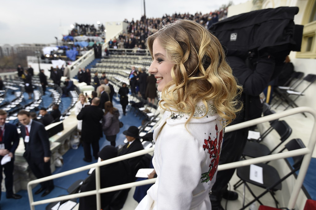 . Singer Jackie Evancho arrives on Capitol Hill in Washington, Friday, Jan. 20, 2017, for the presidential inauguration of Donald Trump. (Saul Loeb/Pool Photo via AP)