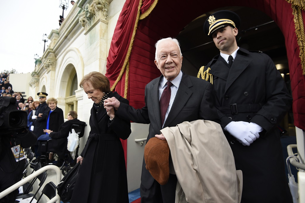 . Former President Jimmy Carter and his wife Rosalynn Carter arrive on Capitol Hill in Washington, Friday, Jsan. 20, 2017, for the presidential inauguration of Donald Trump. (Saul Loeb via AP, Pool)