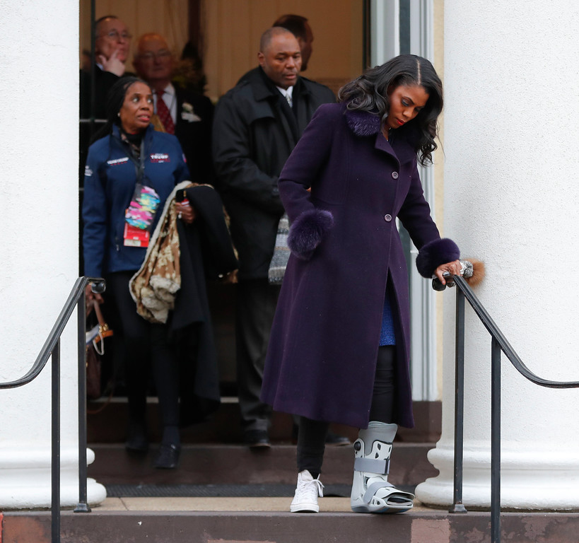 . Omarosa Manigault walks down the stairs after attending church service at St. John\'s Episcopal Church across from the White House in Washington, Friday, Jan. 20, 2017. (AP Photo/Pablo Martinez Monsivais)