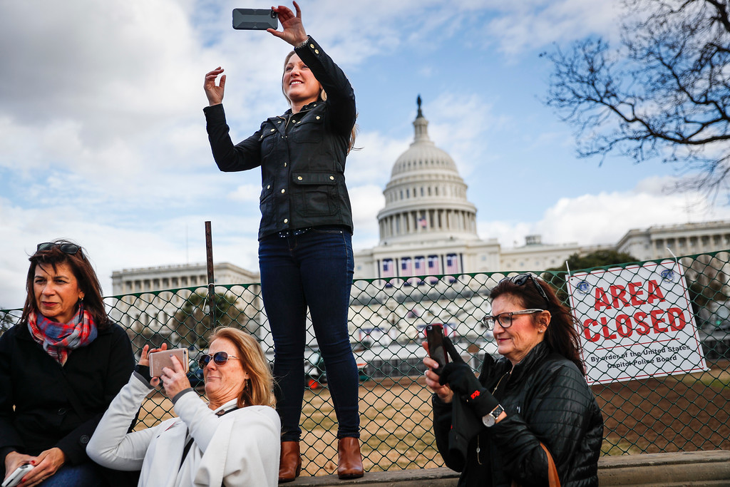 . Micaela Johnson, of Leewood, Kan., in town to take part in Saturday\'s Women\'s March on Washington, takes a selfie with the Capitol Building in the background as preparations continue for Friday\'s presidential inauguration, Wednesday, Jan. 18, 2017, in Washington. (AP Photo/John Minchillo)