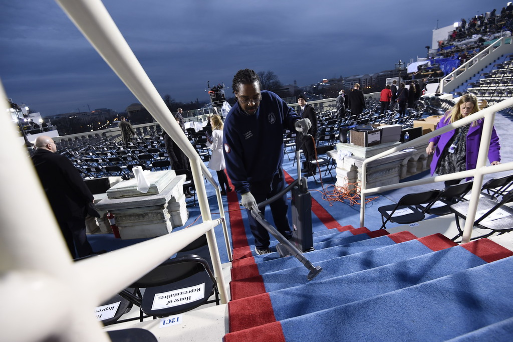 . A worker cleans steps on the inaugural stand on Capitol Hill in Washington, Friday, Jan. 20, 2017, before the inauguration of Donald Trump as the 45th president of the United States. (Saul Loeb via AP, Pool)