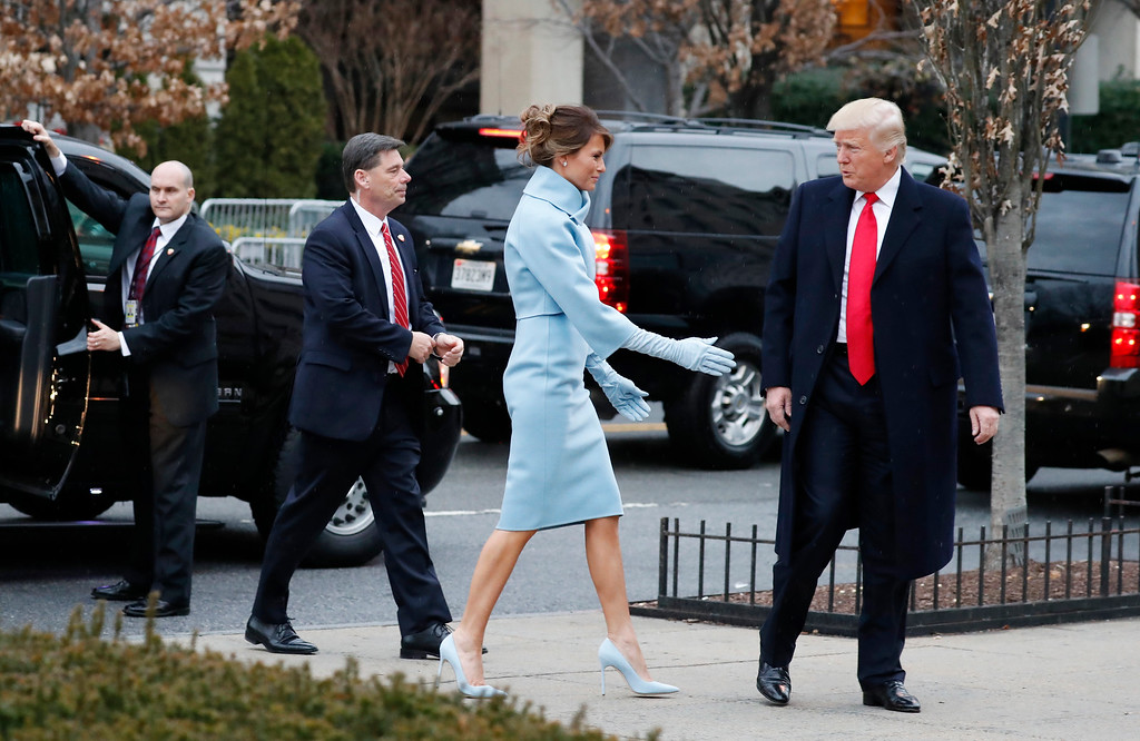 . President-elect Donald Trump and his wife Melania, accompanied by their Secret Service detail, arrives for a church service at St. John�s Episcopal Church across from the White House in Washington, Friday, Jan. 20, 2017, on Donald Trump\'s inauguration day. (AP Photo/Alex Brandon)