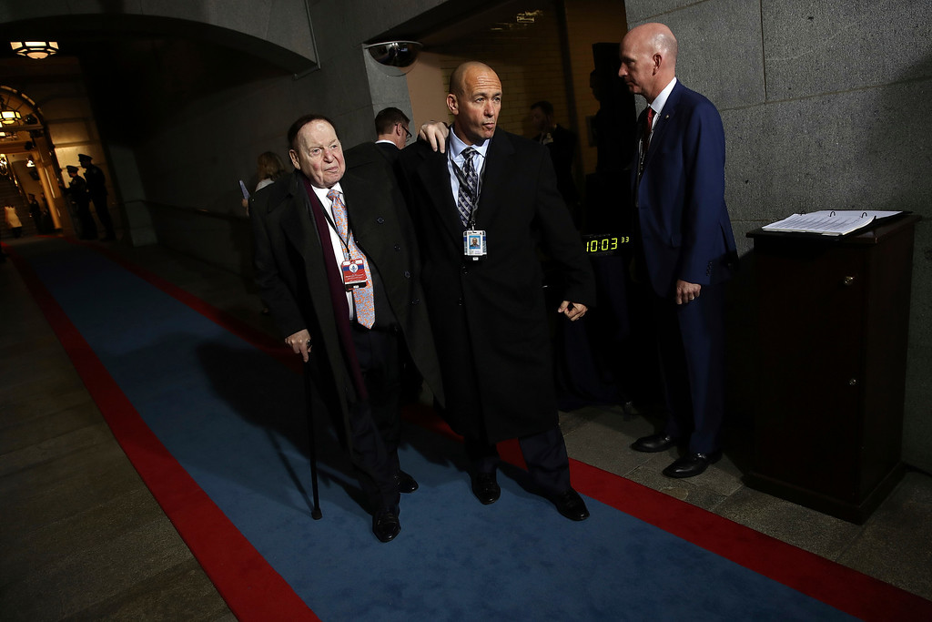 . Sheldon Adelson, left, arrives on the West Front of the U.S. Capitol on Friday, Jan. 20, 2017, in Washington, for the inauguration ceremony of Donald J. Trump as the 45th president of the United States. (Win McNamee/Pool Photo via AP)
