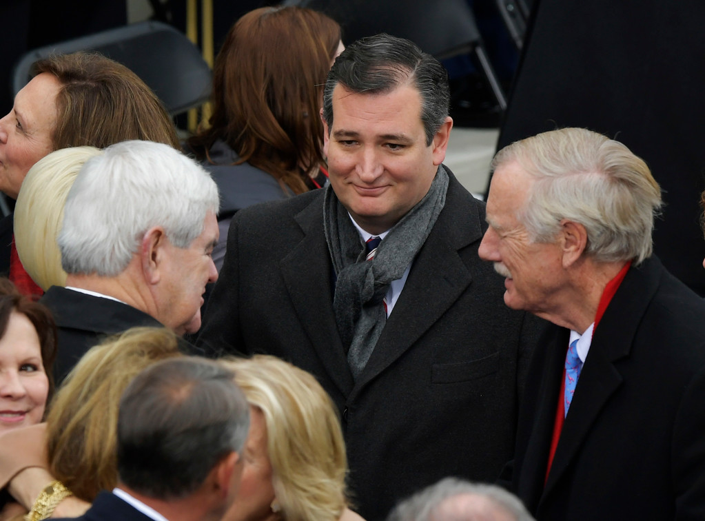 . Senator Ted Cruz, R-Tx., center, listens to former House Speaker Newt Gingrich, left, to during the 58th Presidential Inauguration at the U.S. Capitol in Washington, Friday, Jan. 20, 2017. (AP Photo/Susan Walsh)