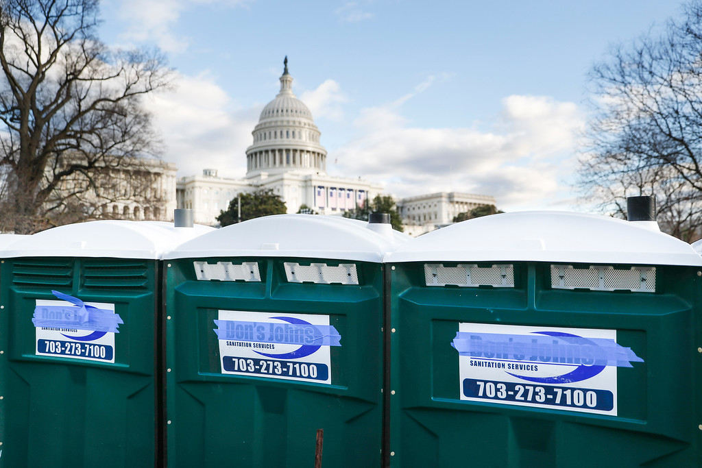 """. Portable toilets have their brand name \""""Don\'s Johns\"""" covered with masking tape as preparations continue for Friday\'s presidential inauguration, Wednesday, Jan. 18, 2017, on Capitol Hill in Washington. (AP Photo/John Minchillo)"""