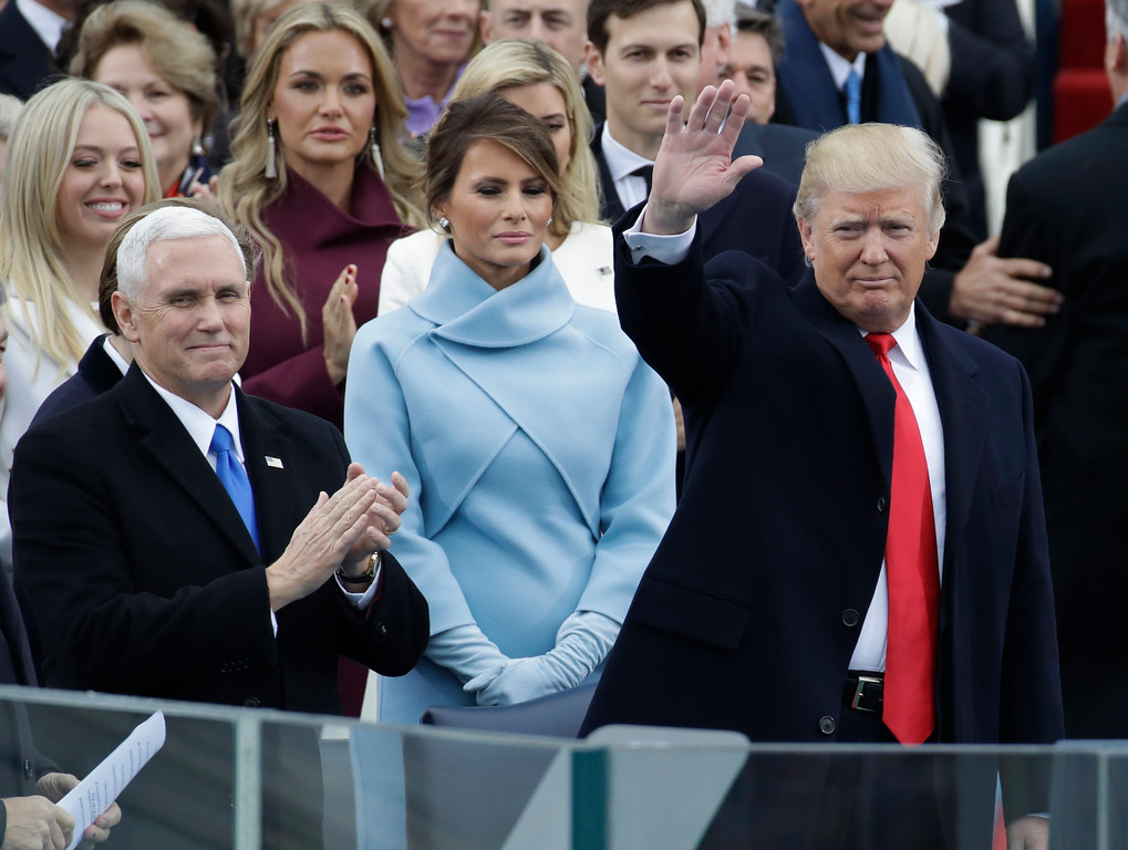 . President-elect Donald Trump waves with Vice President-elect Mike Pence and his wife Melania Trump before the 58th Presidential Inauguration at the U.S. Capitol in Washington, Friday, Jan. 20, 2017. (AP Photo/Patrick Semansky)