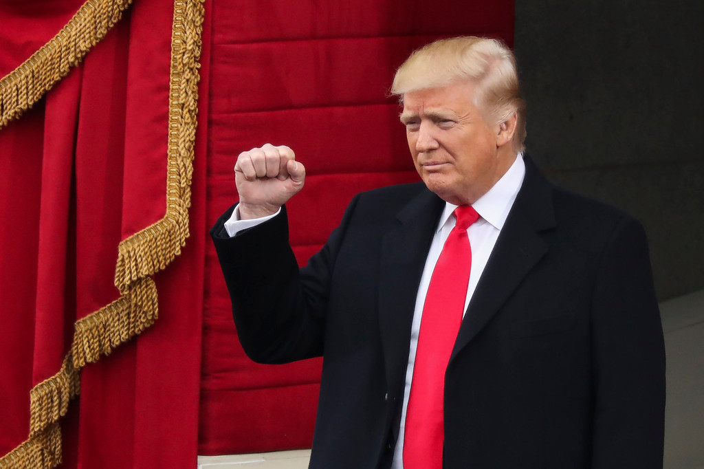 . President-elect Donald Trump pumps his fist as he arrives during the 58th Presidential Inauguration at the U.S. Capitol in Washington, Friday, Jan. 20, 2017. (AP Photo/Andrew Harnik)