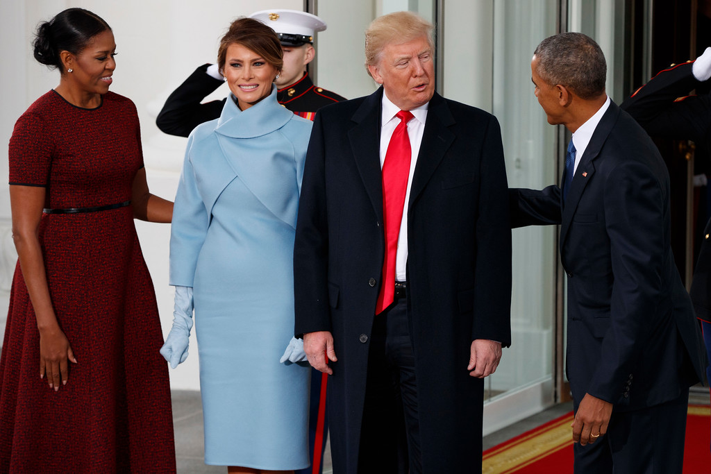 . President Barack Obama and first lady Michelle Obama greet President-elect Donald Trump and Melania Trump at the White House, Friday, Jan. 20, 2017, in Washington. (AP Photo/Evan Vucci)
