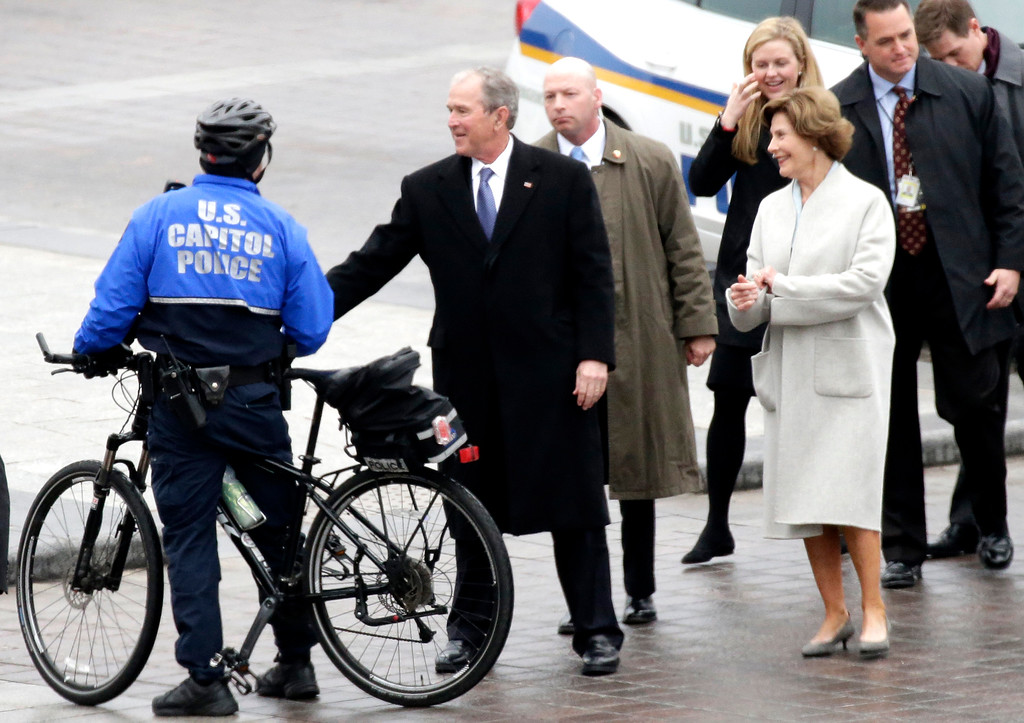 . Former President George W. Bush and wife Laura Bush arrive near the east front steps of the Capitol Building before President-elect Donald Trump is sworn in at the 58th Presidential Inauguration on Capitol Hill in Washington, Friday,  Jan. 20, 2017. (John Angelillo/Pool Photo via AP)