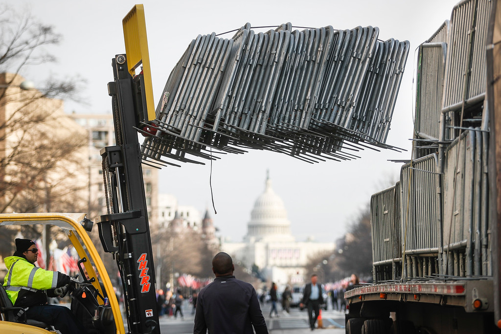 . Workers unload barricades before placing them along Pennsylvania Avenue in Washington, Thursday, Jan. 19,,2017, looking toward the Capitol, as security tightens ahead Friday\'s presidential inauguration. (AP Photo/John Minchillo)