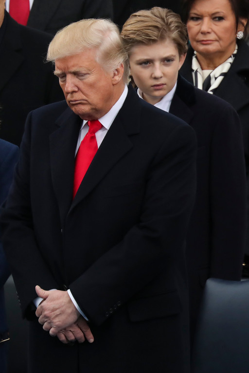 . President-elect Donald Trump listens to a prayer as his son Barron Trump stands in the background during the 58th Presidential Inauguration at the U.S. Capitol in Washington, Friday, Jan. 20, 2017. (AP Photo/Andrew Harnik)