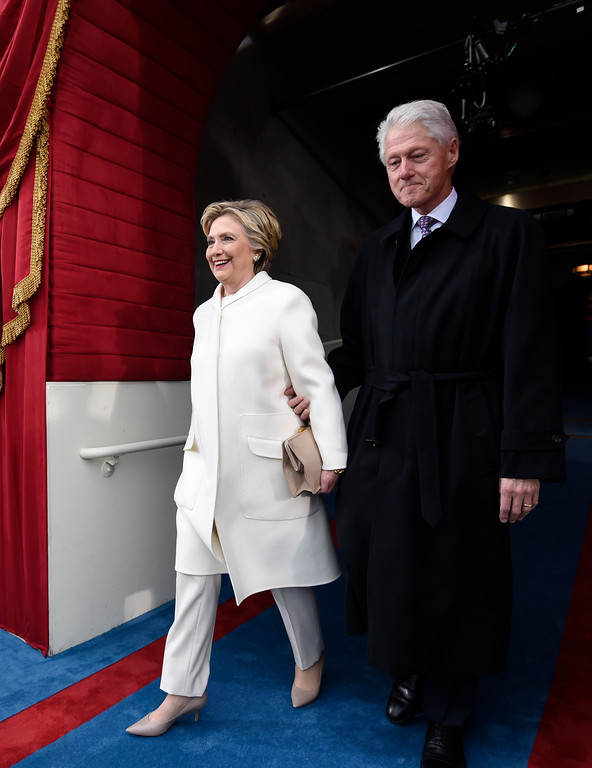 . Former President Bill Clinton and his wife Hillary Clinton arrive on Capitol Hill in Washington, Friday, Jan. 20, 2017, for the presidential inauguration of Donald Trump. (Saul Loeb via AP, Pool)