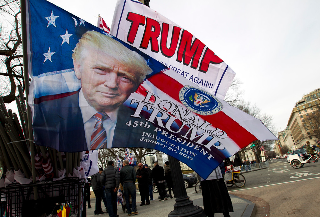 . Flags with the image of President-elect Donald Trump are displayed for sale on Pennsylvania Avenue in Washington, Thursday, Jan. 19, 2017,  ahead of Friday\'s inauguration. ( AP Photo/Jose Luis Magana)