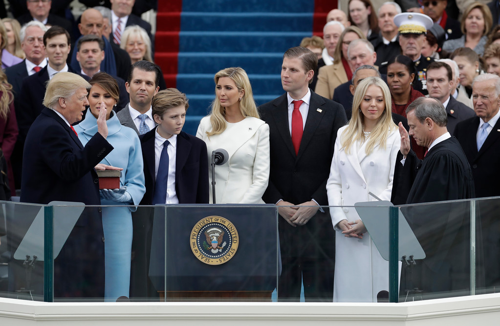 . Donald Trump is sworn in as the 45th president of the United States by Chief Justice John Roberts as Melania Trump and his family looks on during the 58th Presidential Inauguration at the U.S. Capitol in Washington, Friday, Jan. 20, 2017. (AP Photo/Patrick Semansky)