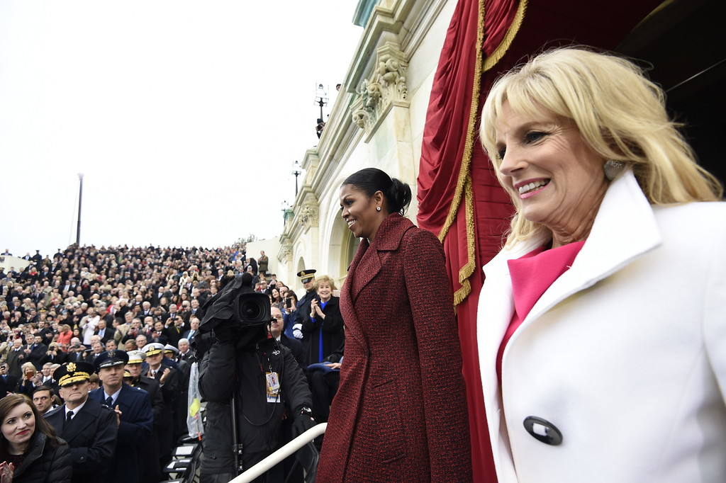 . First lady Michelle Obama and Jill Biden arrive on Capitol Hill in Washington, Friday, Jan. 20, 2017, for the presidential inauguration of Donald Trump. (Saul Loeb/Pool Photo via AP)