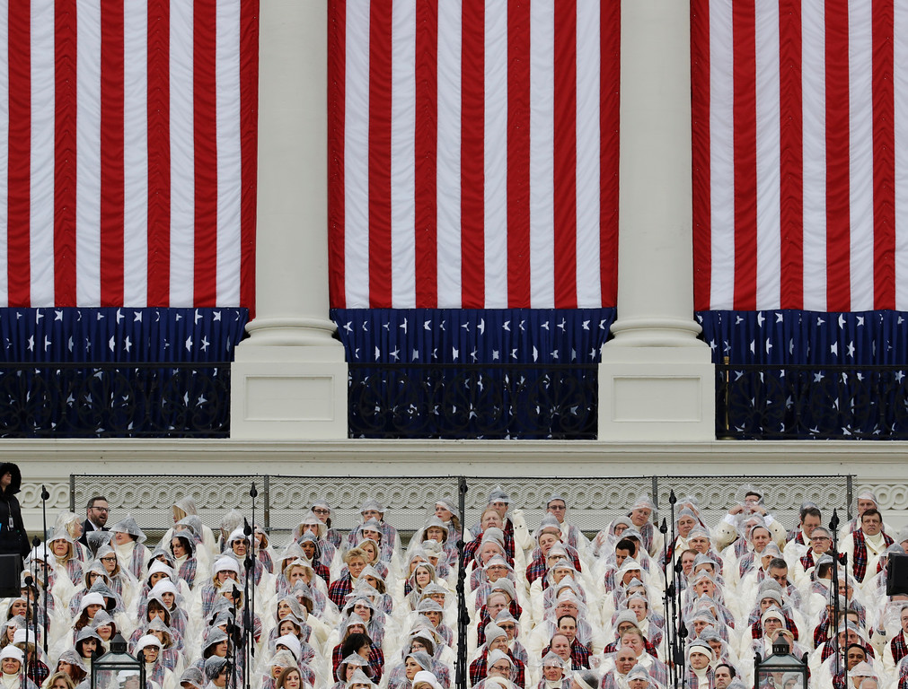. Members of the Mormon Tabernacle Choir wait for the swearing in of Donald Trump as the 45th president of the Untied States during the 58th Presidential Inauguration at the U.S. Capitol in Washington. Friday, Jan. 20, 2017 (AP Photo/Patrick Semansky)