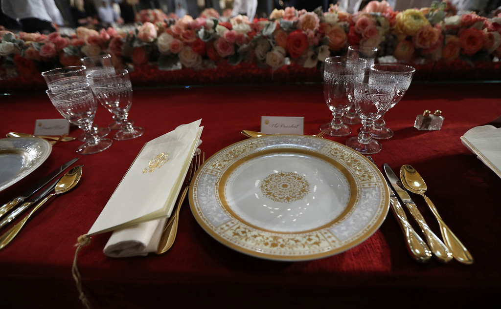 . Table setting is shown for the luncheon with the newly sworn president in Statuary Hall in the Capitol, Friday, Jan. 20, 2017 in Washington. President-elect Donald Trump will become the 45th United States president when he\'s sworn in less than an hour today. (AP Photo/Manuel Balce Ceneta)