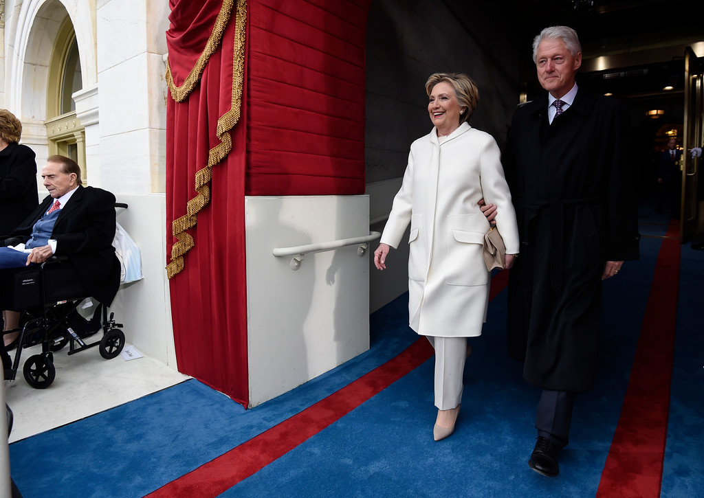 . Former US President Bill Clinton and First Lady Hillary Clinton arrive for the Presidential Inauguration of Donald Trump at the US Capitol in Washington, DC, January 20, 2017. / AFP PHOTO / POOL / SAUL LOEB