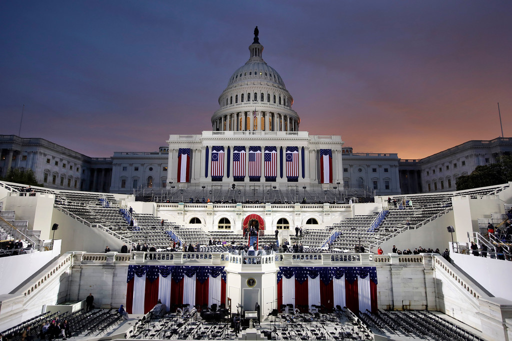 . Dawn breaks behind the Capitol Dome as last minute preparations continue for swearing in of Donald Trump as the 45th President of the United States during the 58th Presidential Inauguration at the U.S. Capitol in Washington. Friday, Jan. 20, 2017 (AP Photo/Patrick Semansky)