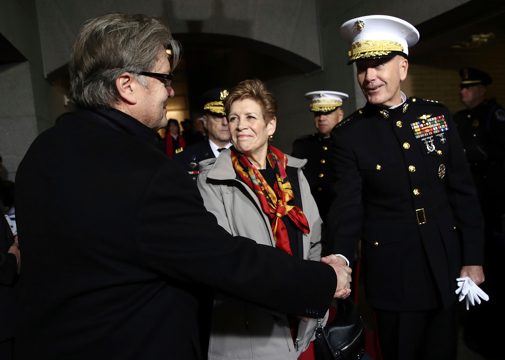 . Steve Bannon, left, and Chairman of the Joint Chiefs of Staff Gen. Joseph F. Dunford arrive on the West Front of the U.S. Capitol on Friday, Jan. 20, 2017, in Washington, for the inauguration ceremony of Donald J. Trump as the 45th president of the United States. (Win McNamee/Pool Photo via AP)