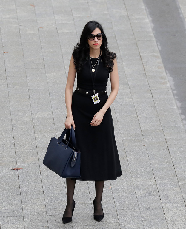 . Hillary Clinton aide Huma Abedin arrives near the east front steps of the Capitol Building before President-elect Donald Trump is sworn in at the 58th Presidential Inauguration on Capitol Hill in Washington, Friday,  Jan. 20, 2017. (John Angelillo/Pool Photo via AP)