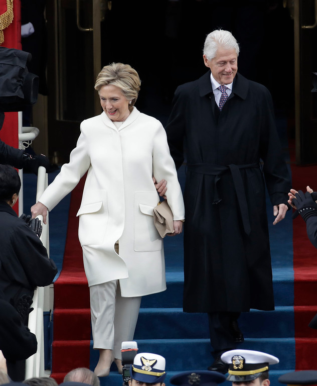 . Former President Bill Clinton and Former Secretary of State Hillary Clinton arrive for the 58th Presidential Inauguration at the U.S. Capitol for President-elect Donald Trump in Washington, Friday, Jan. 20, 2017. (AP Photo/Patrick Semansky)